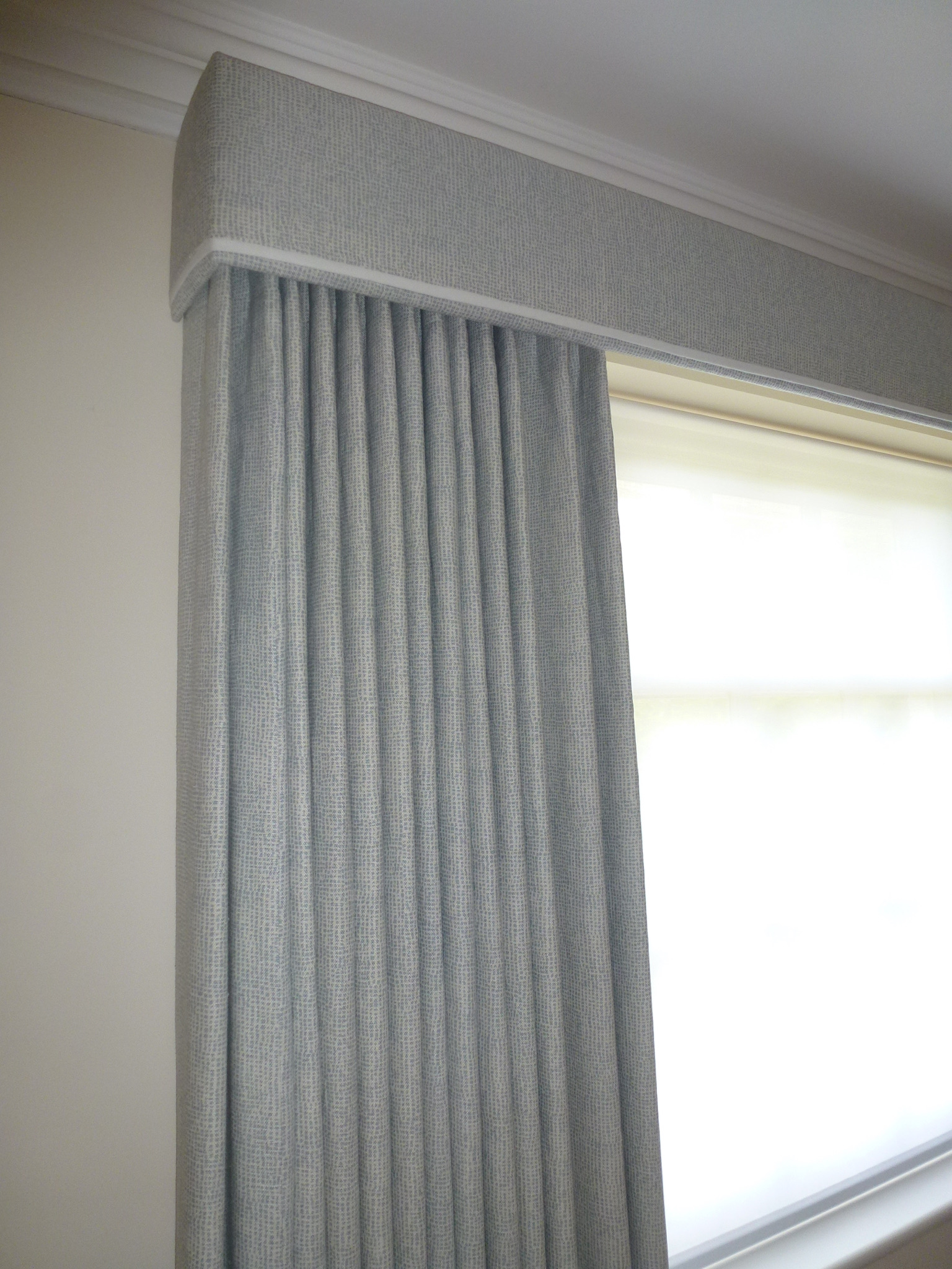 single pinch pleat curtains under pelmet with cream trim